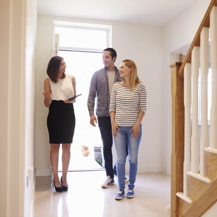 Realtor walking clients through house