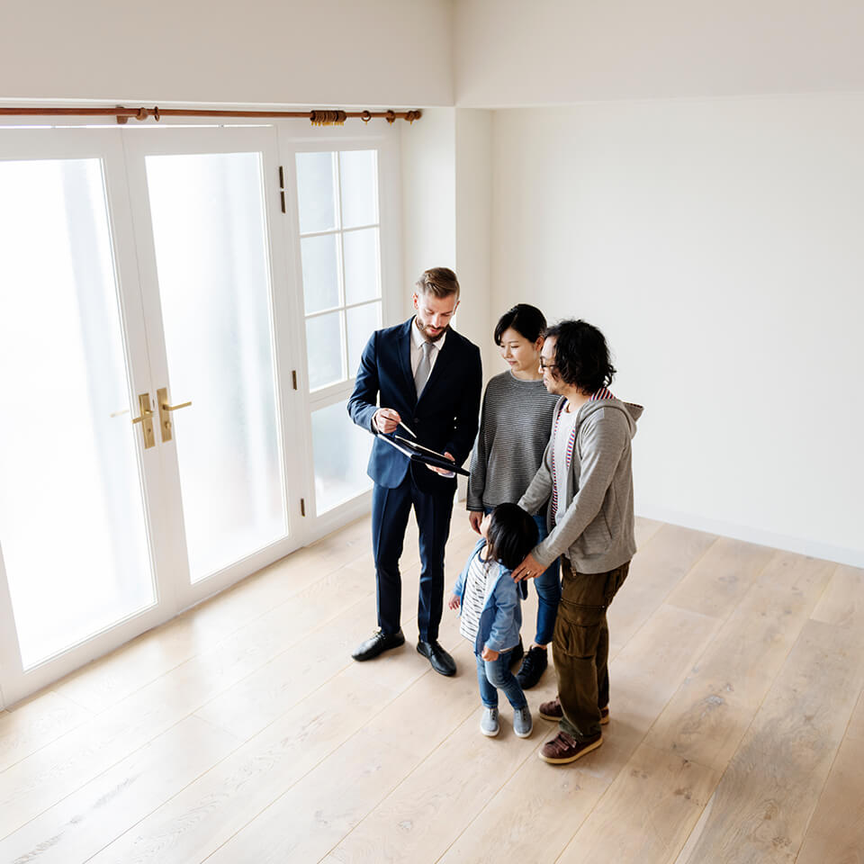 home buyers talking in an empty room